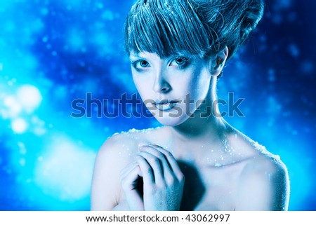 Portrait of a snow female model over sky of stars and snow. Fashion, beauty. - stock photo