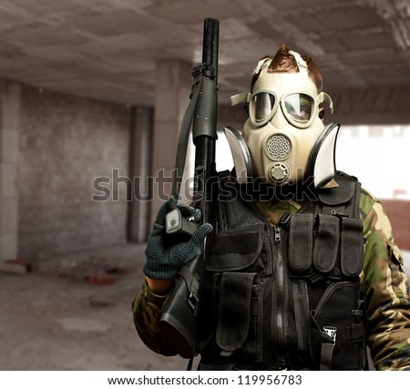 Portrait Of A Soldier With Gas Mask, indoor - stock photo