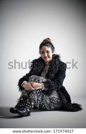Portrait of a somber young Asian woman - stock photo