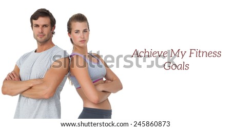 Portrait of a sporty young couple with arms crossed over white background - stock photo