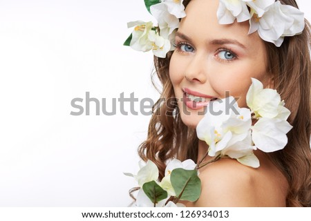 Portrait of a springtime beauty with branches of flowers in her hair - stock photo