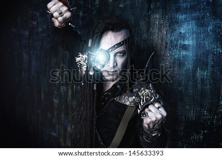 Portrait of a steampunk man over grunge background. - stock photo