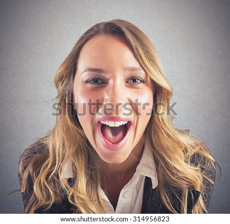 Portrait of a stressed businesswoman that screams - stock photo