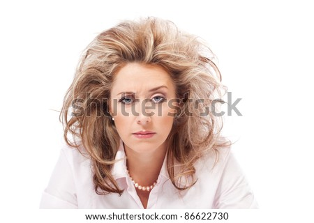 Portrait of a stressed out woman raising one eyebrow - stock photo