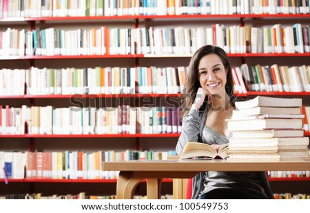 Portrait of a student  girl studying at library - stock photo