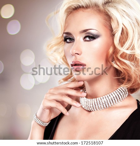 Portrait of a style beautiful woman over art creative background - stock photo
