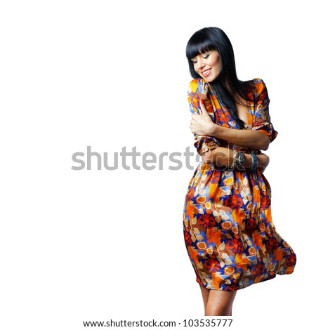 Portrait of a stylish confident woman standing with arms crossed isolated on white background - stock photo