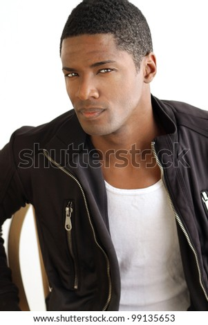 Portrait of a stylish cool young man in leather jacket against white background - stock photo