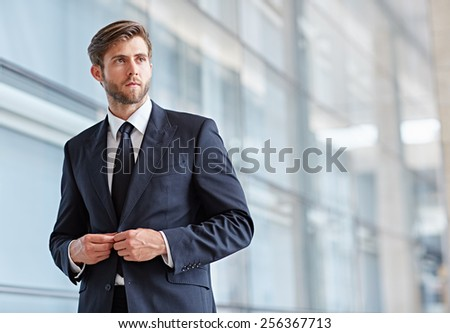 Portrait of a stylish corporate executive looking seriously away into the distance - stock photo
