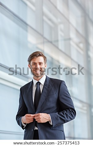 Portrait of a stylish corporate executive smiling confidently at the camera - stock photo