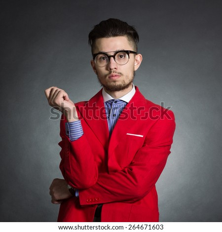 Portrait of a stylish male hipster in red jacket. - stock photo