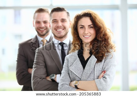 Portrait of a stylish young businesswoman and her successful business team at office - stock photo
