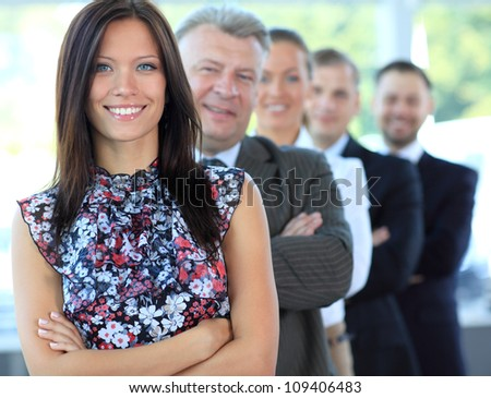 Portrait of a stylish young businesswoman with her successful business team at office - stock photo