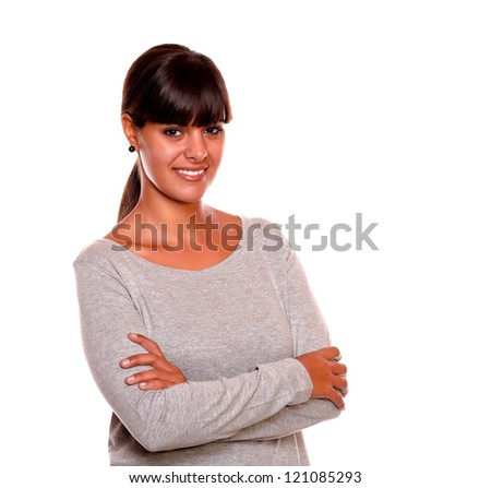 Portrait of a stylish young woman smiling and looking at you standing over white background - stock photo