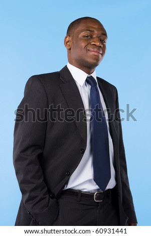 Portrait of a successful business man isolated on a blue background - stock photo