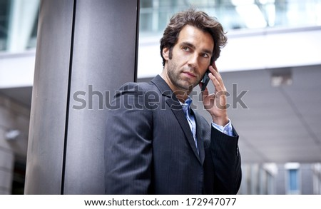Portrait Of A Successful Businessman on the phone - stock photo