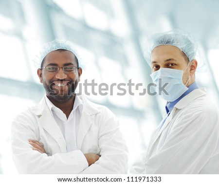 Portrait of a successful doctors in hospital - stock photo