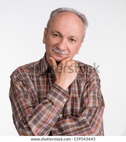 Portrait of a successful elderly man on white background - stock photo