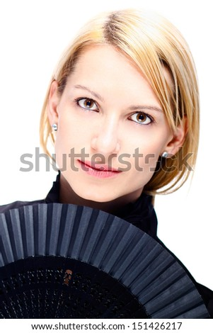 Portrait of a successful,  elegant, attractive, business woman wearing black blouse holding folding fan. - stock photo