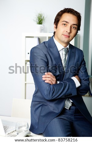 Portrait of a successful employer in formalwear looking at camera - stock photo
