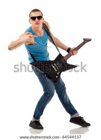 Portrait of a successful rock star holding an electric guitar and making a rock sign - stock photo