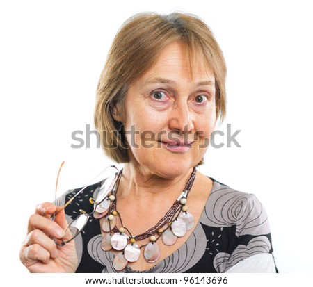 Portrait of a successful senior woman standing over white background - stock photo