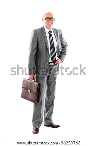 Portrait of a successful young business man carrying a suitcase on white background - stock photo
