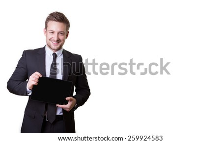 Portrait of a successful young business man demonstrates tablet isolated on white background - stock photo