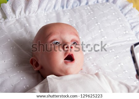 Portrait of a Surprised  Baby Boy - stock photo