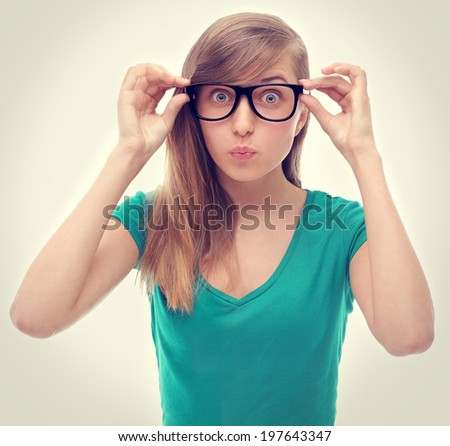 Portrait of a surprised  girl, puffed out his cheeks and blowing - stock photo