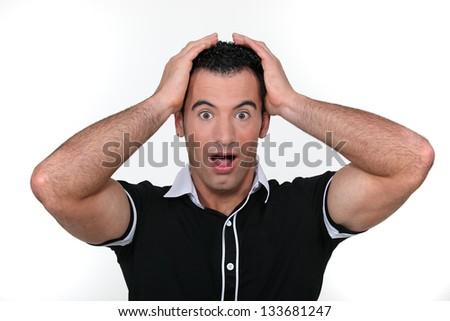 Portrait of a surprised man - stock photo