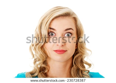 Portrait of a surprised woman with big eyes. - stock photo