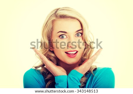 Portrait of a surprised woman with open mouth. - stock photo