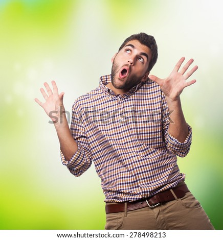 portrait of a surprised young man closeup - stock photo