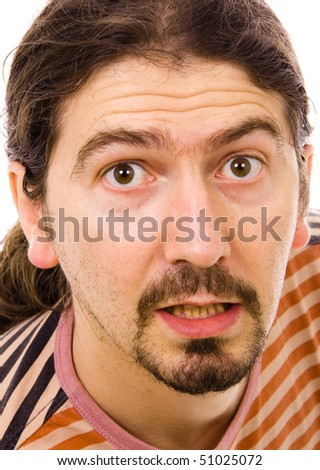 Portrait of a surprised young man, over white background - stock photo