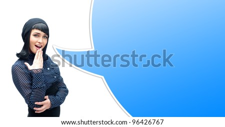 Portrait of a surprised young woman with hands over her mouth laughing against white background. Blank balloon for your text and logo - stock photo