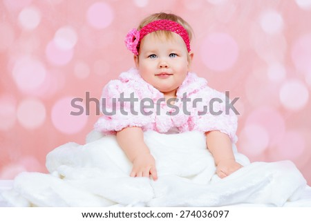 Portrait of a sweet baby girl. Newborn. Happy childhood. - stock photo