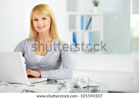 Portrait of a sweet business girl looking at camera and smiling, copy-space provided - stock photo