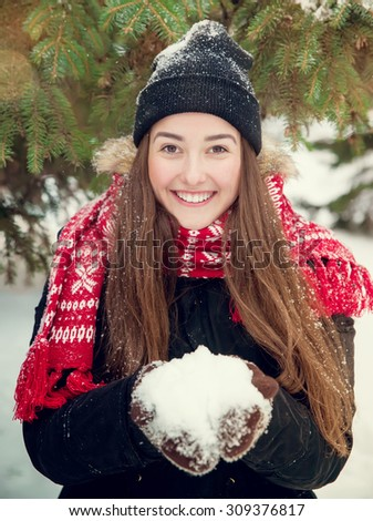 portrait of a sweet girl with a red scarf Christmas, close-up - stock photo