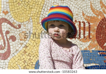 portrait of a sweet girl with colourful mosaic - stock photo