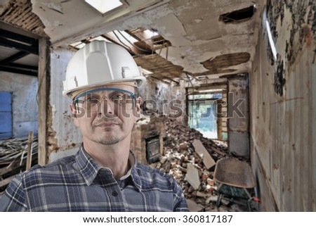 Portrait of a technician for Home improvement at the stage of demolition before renovation - stock photo
