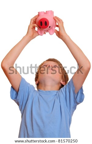 Portrait of a teenage boy trying to empty his piggy bank - stock photo