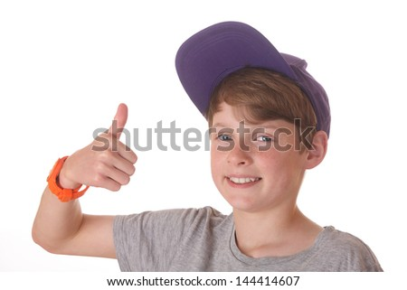 Portrait of a teenage boy with cap and thumbs up - stock photo