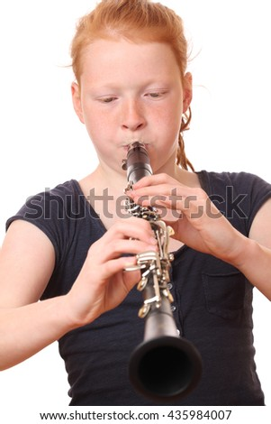 Portrait of a teenage girl playing clarinet on white background - stock photo