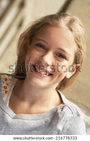 Portrait of a teenage girl smiling. - stock photo