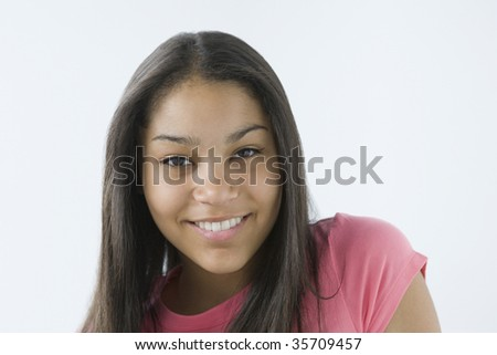 Portrait of a teenage girl smiling into camera. - stock photo