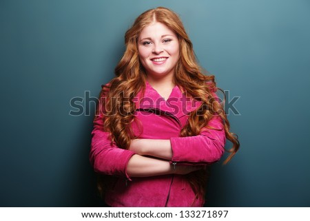 Portrait of a teenage girl with arms crossed - stock photo