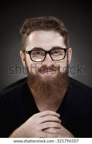 Portrait of a Teenage Hipster with Beard and Glasses - stock photo