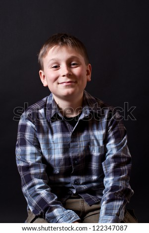 portrait of a teenager on a black background - stock photo