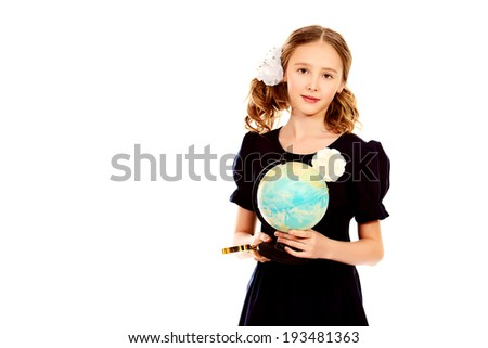 Portrait of a ten years schoolgirl uniform holding a globe. Isolated over white. - stock photo